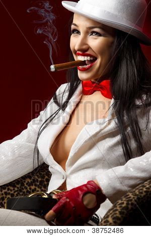 Fashion model wears white clothes with cigar and retro headphones