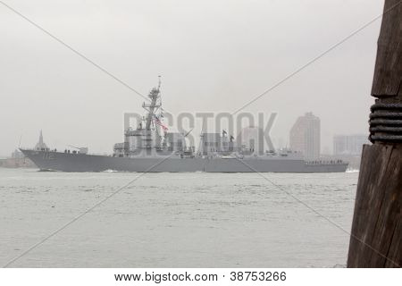 NEW YORK-OCT 9: USS Michael Murphy (DDG 112) passes Ellis Island as it departs New York Harbor in rain and fog fully commissioned into active service in New York on October 9, 2012.