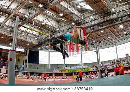 LINZ, AUSTRIA - FEBRUARY 25: Josip Kopic (#28, Austria) places second in the men's high jump event in Linz, Austria on February 25, 2012.
