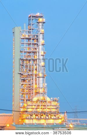 Distillation tower at Oil Refinery Plant at dusk
