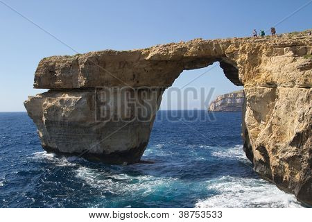 GOZO, MALTA - JUNE 6: Tourist visiting the famous stone arch, Azure Window, on June 6, 2012 in Gozo, Malta. According to Malta�´s National Statistics Office, 1.4 million tourist visited Malta in 2011.