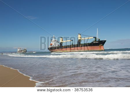 VALENCIA, SPAIN - SEPT 30: The cargo ships BSLE Sunrise of Panama (foreground) and the Celia of St Johns runs aground at the El Saler Beach after a big storm on September 30, 2012 in Valencia, Spain.