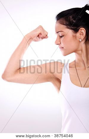 Attracitve fitness girl showing her muscles