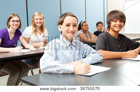 Diverse group of middle-school children in class.