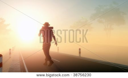 Silhouette of a man on the road.