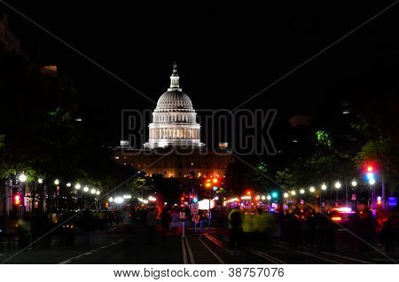 Washington DC, United States Capitol building at night with walking people trails at Pennsylvania Avenue