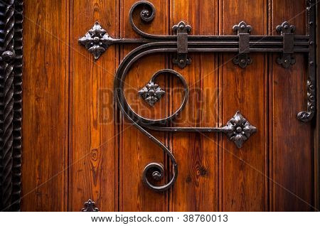 Wooden door with metal decoration