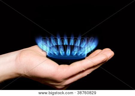 Hands holding a flame gas