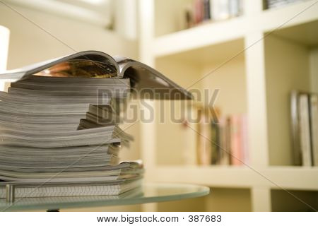 Magazines On A Crystal Table