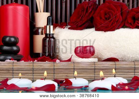 Beautiful spa setting near pool on bamboo background