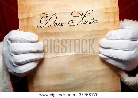 Close-up of Christmas letter in Santa Claus hands