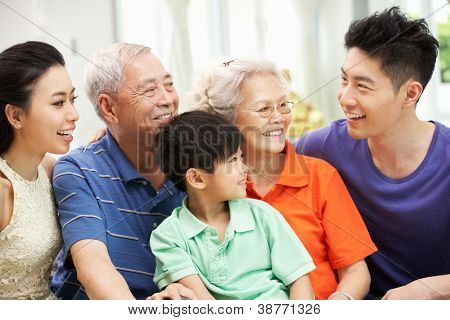 Portrait Of Multi-Generation Chinese Family Relaxing At Home Together