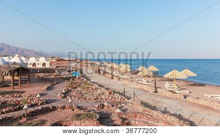 View of the beach with umbrellas in Dahab, Egypt.