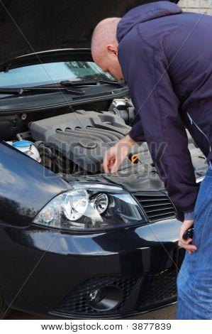 Road Breakdown. Man Attempts To Repair Own Automobile