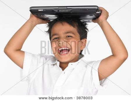 Asian Boy Holding Laptop On His Head