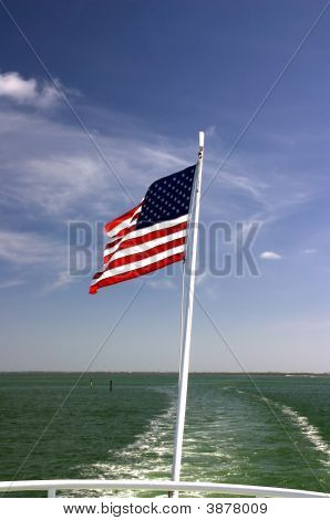 Speedboat And Wake And Flag