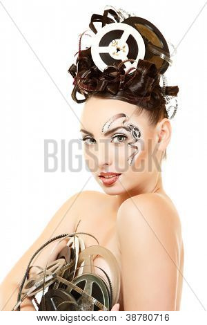 portrait of woman with beautiful art film movie make-up and hairstyle holding vintage spools isolated on white background