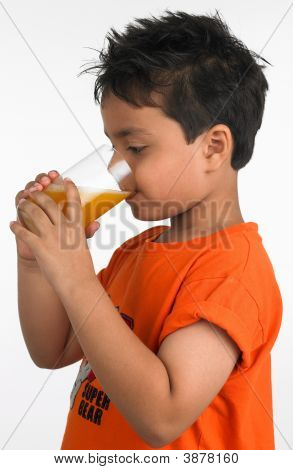 Asian Boy Drinking A Glass Of Juice