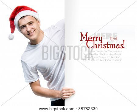cute man in a Santa Claus hat behind the white board with space for text