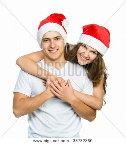 Beautiful Christmas couple in Santa hats on a white background
