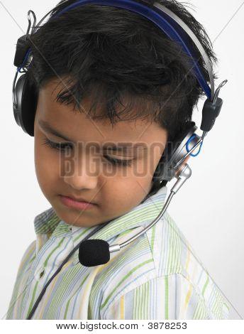 Boy Of Indian Origin With Headphones Enjoying His Music