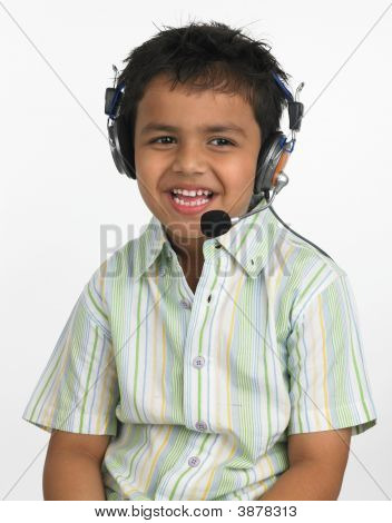 Asian Boy Of Indian Origin With Headphones
