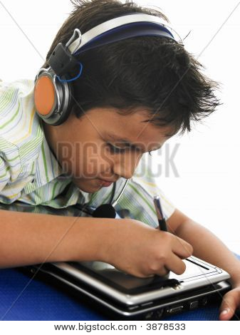 An Adorable Looking Asian School Boy With His Laptop