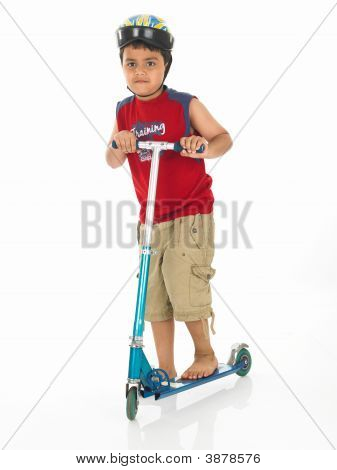 Asian Boy Of Indian Origin With His Scooter