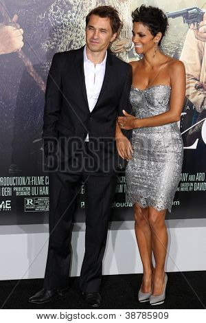 HOLLYWOOD, CA - OCTOBER 24: Olivier Martinez and Halle Berry arrive at the premiere of Warner Bros. Pictures 'Cloud Atlas' at Grauman's Chinese Theatre on October 24, 2012 in Hollywood, California.