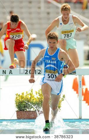 BARCELONA - JULY, 13: Italo Quazzola of Italy during 3000m steeplechase event the 20th World Junior Athletics Championships at the Stadium on July 13, 2012 in Barcelona, Spain