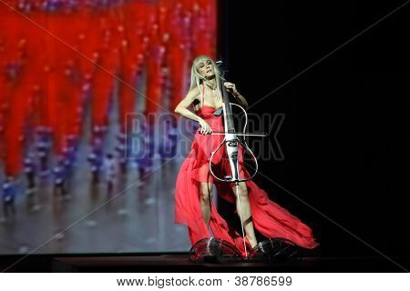 ZAGREB, CROATIA - OCTOBER 18: Ana Rucner playing cello and wearing dress made by Elfs on 'Croaporter' fashion show, on October 18, 2012 in Zagreb, Croatia.