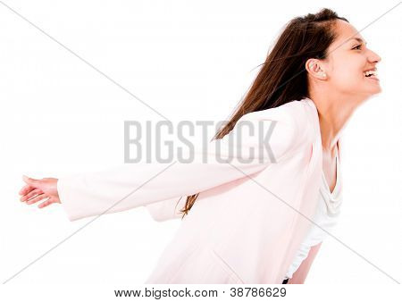 Woman enjoying her freedom with arms open - isolated over white