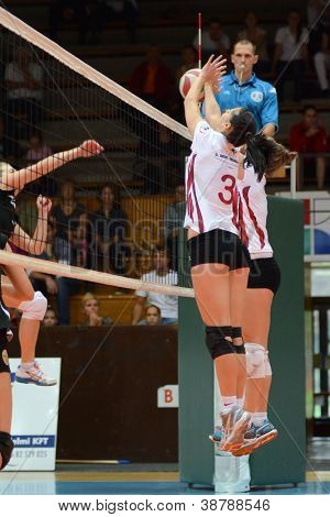 KAPOSVAR, HUNGARY - OCTOBER 7: Zsofia Harmath  (white 3) in action at the Hungarian I. League volleyball game Kaposvar (white) vs Veszprem (black), october 7, 2012 in Kaposvar, Hungary.