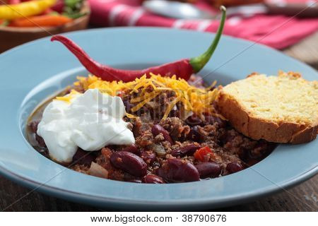 Chili con carne with Cheddar cheese and sour cream