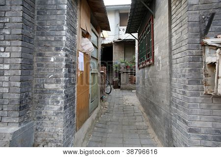 old Manchurian styled buildings and alley ways of over 200 years old in hutong area of Beijing, China.