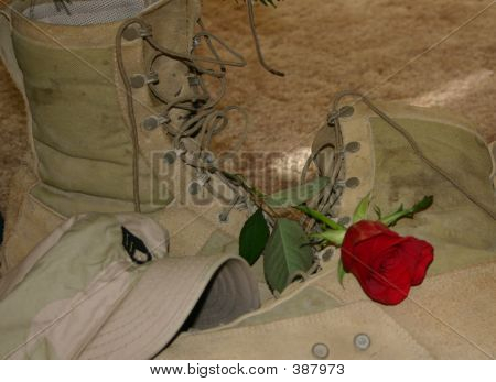 Military Boots And Single Red Rose