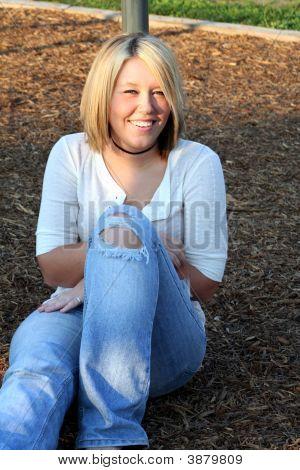 Blond On Playground Sit