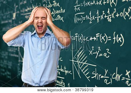 stressed man and blackboard background