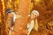 Photo of happy young family having fun in autumnal woods, closeup portrait of cute cheerful couple p