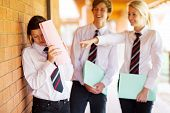 stock photo of school bullying  - high school girl being bullied by classmates - JPG