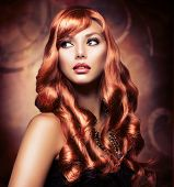 pic of wavy  - Portrait of a Beautiful Girl With Healthy Long Red Hair and Holiday Makeup - JPG