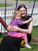 stock photo of swingset  - My daughter and granddaughter swinging together on our swingset - JPG