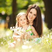 stock photo of cuddling  - Mother and daughter in the park - JPG