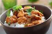pic of curry chicken  - Chicken curry with rice and parsley in a bowl - JPG