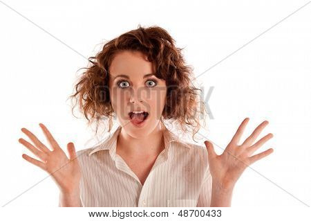 Beautiful young woman looking very shocked at something in a studio