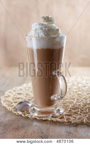 Coffee Latte Macchiato With Whipped Cream In Tall Glass