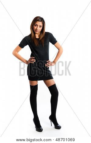 Full portrait of a beautiful Asian Indian female model in a short dress and high socks