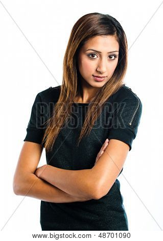 Beautiful young Indian model posing with her arms folded