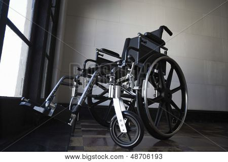 Low angle view of a wheelchair in empty room