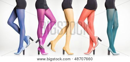 Collection Of Colorful Stockings On Sexy Woman Legs Isolated On Grey